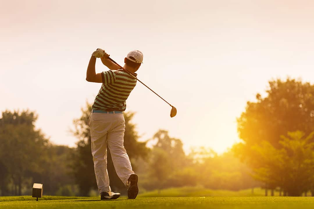 golfershitsweepinggolfcourseinthesummer