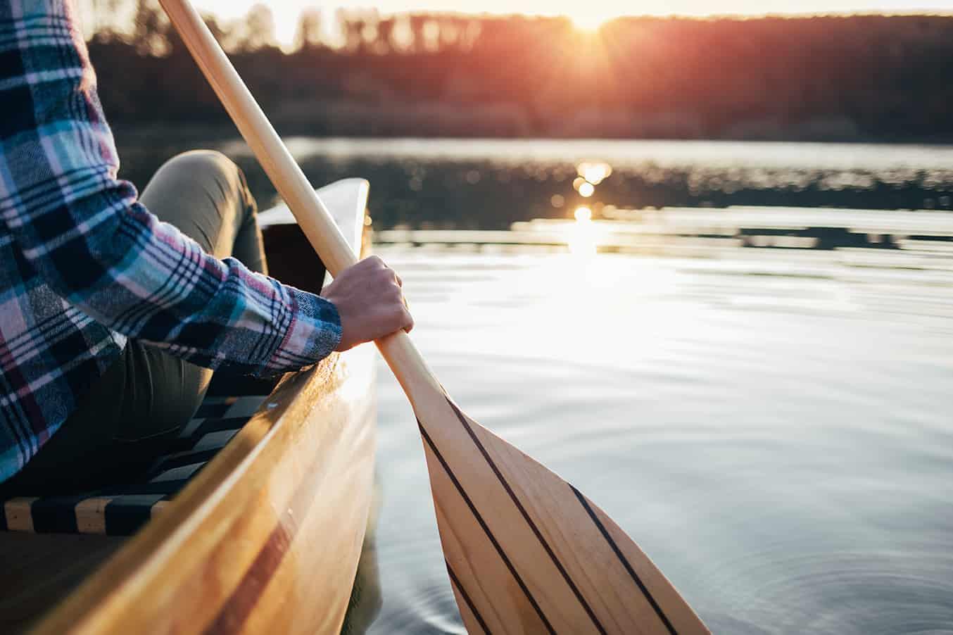 closeupofhipstergirlholdingcanoepaddle-canoeingon